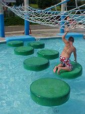 Boy playing in swimming pool equipment